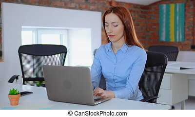 white collar worker using computer - posing looking at the...