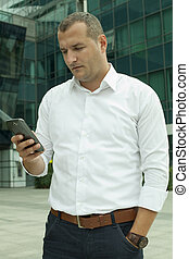 White Collar Worker with a Mobile Phone in Hand