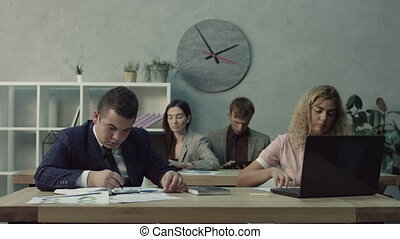White-collar workers doing routine job in office -...