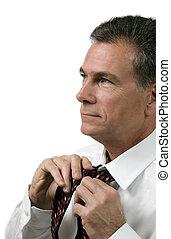 White Collar Working Man - Man in a white shirt tying his...