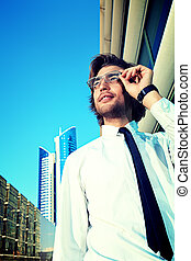 white collar - Young business man standing on the street of...