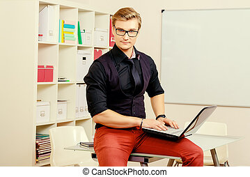 white collar - Young businessman working with laptop at the...