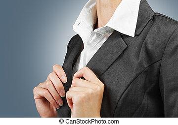 White collar - Young businesswoman straightens collar