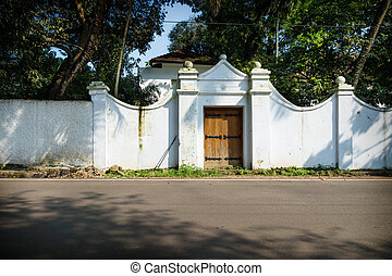 White colonial entrance of house along the road, Kochi, Kerala, India