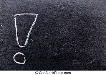 White color chalk hand drawing in exclamation mark with blank space shape on blackboard background