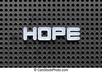 White color letter in word hope on black pegboard background