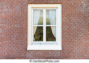 White color vintage style window with brick wall