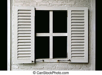 White colored wooden window on white painted brick wall