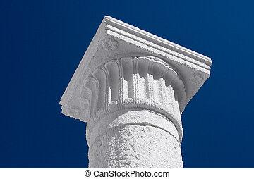 White column and capital against the dark blue sky