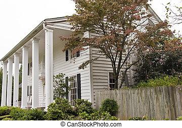 White Columned Wood Siding House and Fence