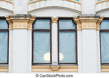 white columns on the facade of the building in classical style