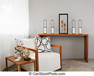 white comfortable sofa seat with interior design items