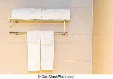 White comfortable towel on wall decoration in bathroom