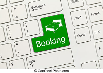 White conceptual keyboard - Booking (green key) - Close-up...