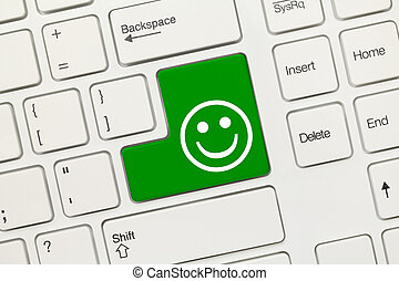 White conceptual keyboard - Good mood (green key) - Close-up...