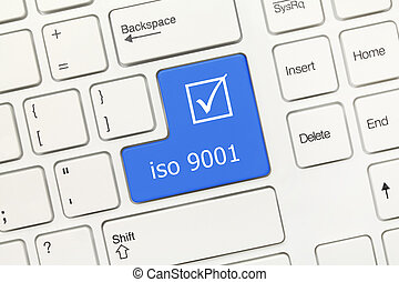 White conceptual keyboard - iso 9001 (blue key) - Close-up...