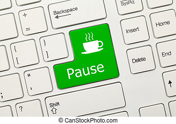 Close-up view on white conceptual keyboard - Pause (green key)
