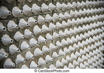 White cone pattern on the wall