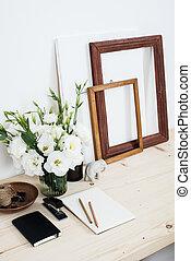 White contemporary feminine work desk with flowers