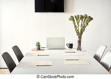 White conversation desk ready for use