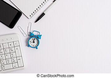 White copy space with pc keyboard clock mobile phone and pencil. Business concept with blank white space for advertising and text message.