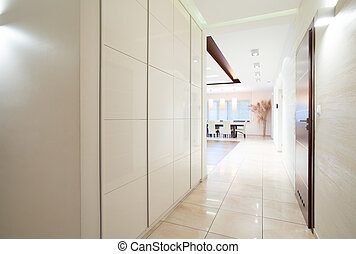 White corridor - Long white corridor with sliding wardrobe
