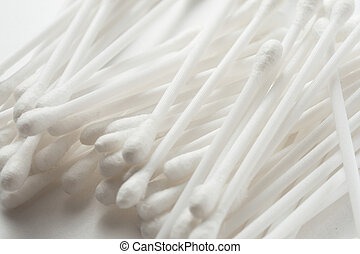 White cotton swabs on white