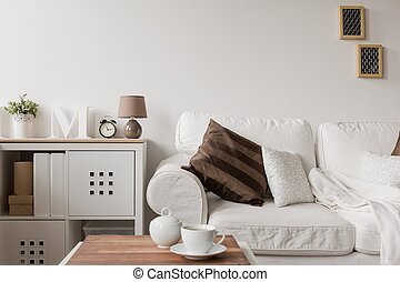 White couch and commode in drawing room
