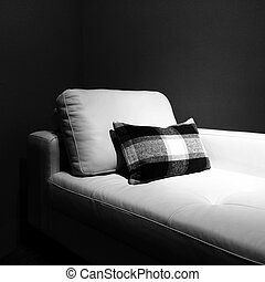 White couch in a dark room