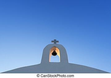White Cross Against The Blue Sky
