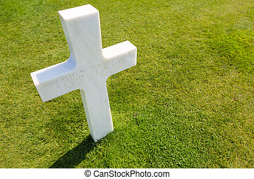 White cross for an unknown soldier at american cemetery in Colleville-sur-mer, Normandie, France