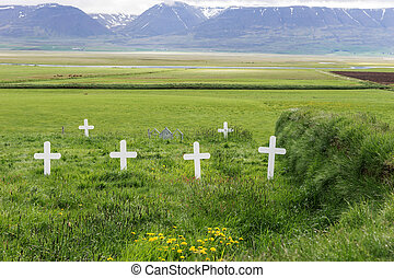 White crosses on a traditional cemetery in Iceland