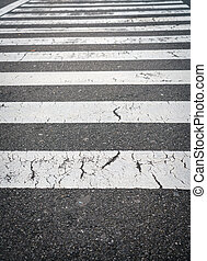White crossing stripes on road