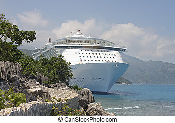 White Cruise Ship anchored on Rocky Coast