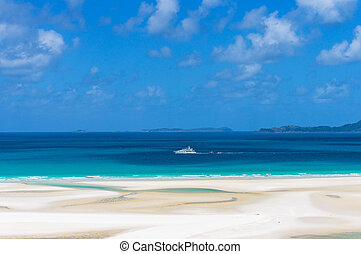 White cruise ship, boat on turquoise blue waters of Coral...