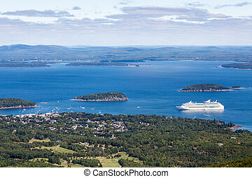 White Cruise Ship in Blue Bay in Maine - Cruise ship in a...
