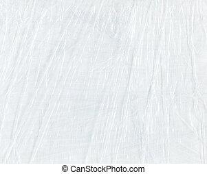 White crumpled cellophane. Polyethylene white texture