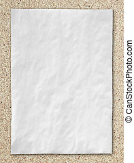 white crumpled paper on cork board background