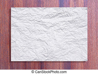 White crumpled paper on wood texture