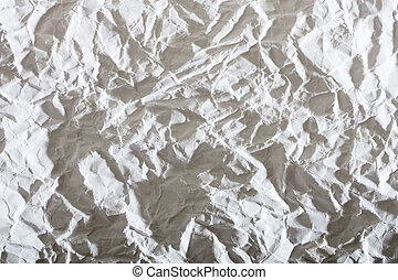 white crumpled paper, with sharp shadows