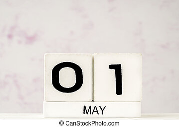 White cube calendar for May with copy space