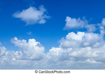 White cumulus clouds against the blue sky