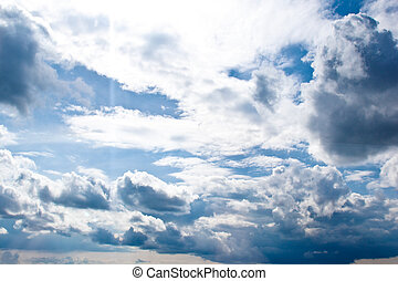 white cumulus clouds in the form of cotton wool on a blue sky. background, bright sky texture
