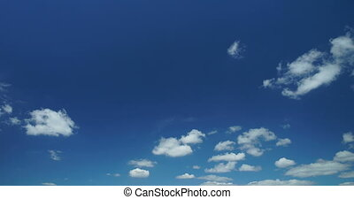 White cumulus clouds on blue sky - Time lapse video of white...