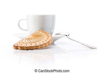 White cup and cookie over white background