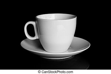 white cup and white saucer with reflection isolated on black background