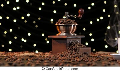 White cup hot drink with smoke and coffee grinder. Studio -...