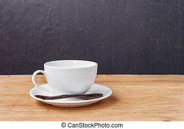 White cup of a coffee on a wooden