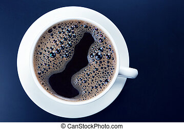 white cup of black coffee on a dark background