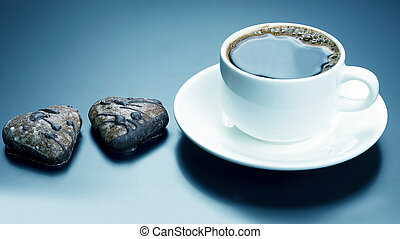 white cup of black coffee with biscuits heart. dessert food